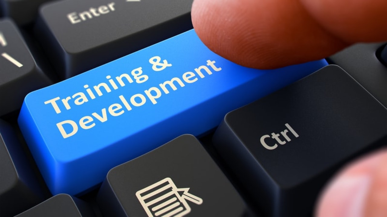 Key on keyboard titled Training & Development